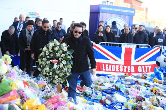 <p>The family of the Leicester owner pay tribute at Leicester City Football Club. Mike Egerton/PA Wire </p>