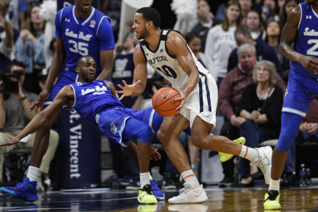 Butler forward Bryce Nze (10) is fouled by Seton Hall guard Quincy McKnight (0) in the second half of an NCAA college basketball game in Indianapolis, Wednesday, Jan. 15, 2020. Seton Hall defeated Butler 78-70. (AP Photo/Michael Conroy)