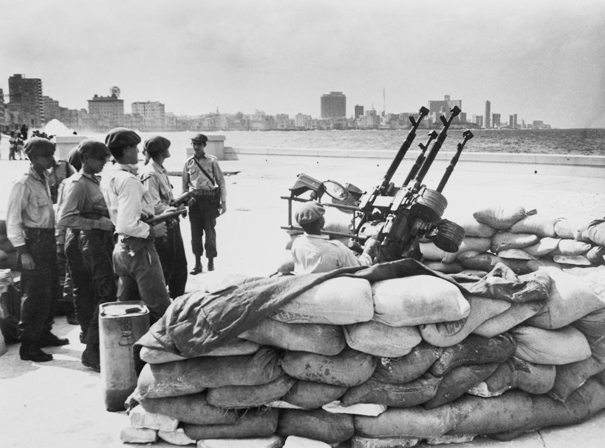Cuban soldiers stand by an anti-aircraft gun on the Havana waterfront in January 1962, in response to a warning of a U.S. invasion. (Photo: Bettmann Archive via Getty Images)