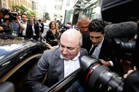 Russian oligarch Boris Berezovsky leaves after losing his court battle against Roman Abramovich at a division of the High Court in London