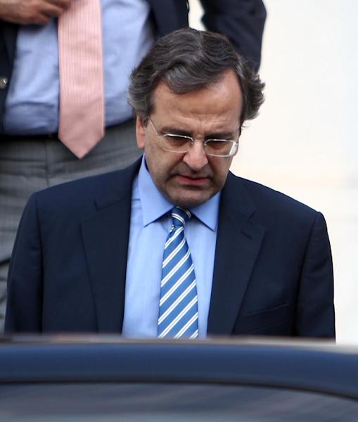 Greece's Prime Minister Antonis Samaras leaves Maximos mansion after his meeting with the other political leaders of the coalition government in Athens, Wednesday, Aug. 1, 2012. A junior partner in Greece's fragile coalition government has dropped objections to new spending cuts demanded by the debt-crippled country's bailout creditors. (AP Photo/Thanassis Stavrakis)