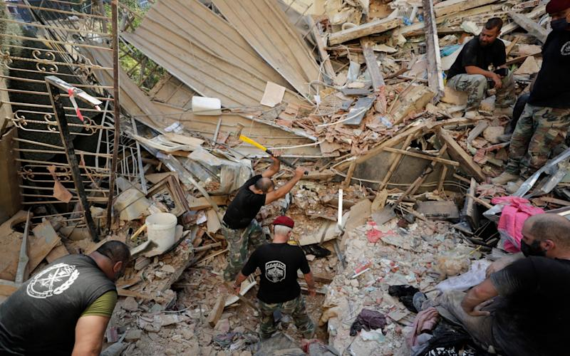 Lebanese soldiers search for survivors - AP Photo/Hassan Ammar
