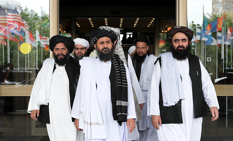 Members of a Taliban delegation, led by chief negotiator Mullah Abdul Ghani Baradar (C, front), leave after peace talks with Afghan senior politicians in Moscow, Russia on May 30, 2019. (Evgenia Novozhenina/Reuters)