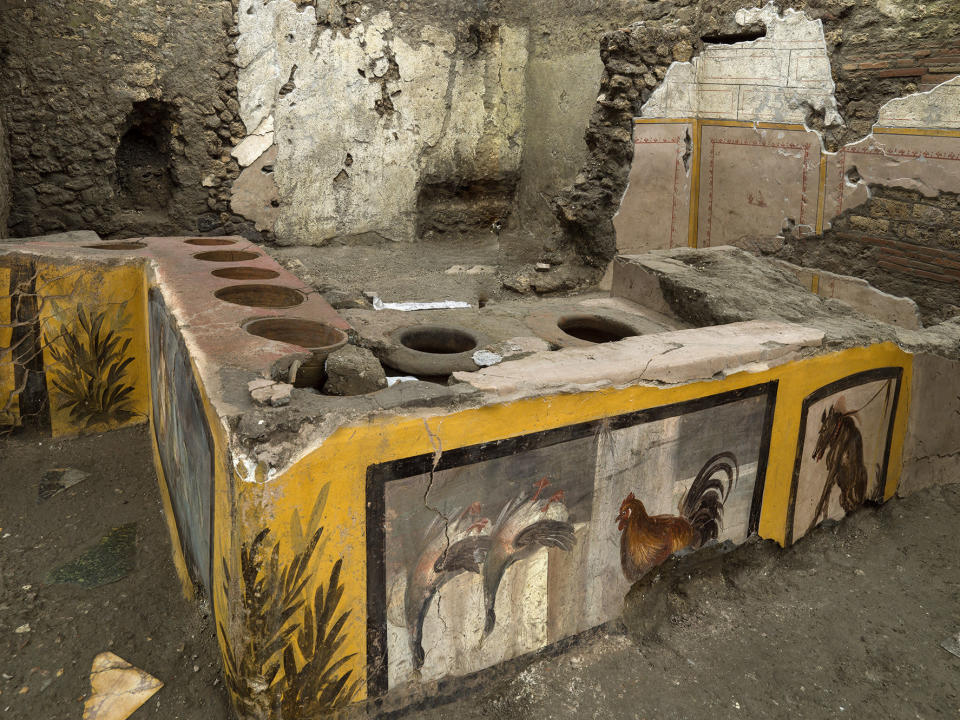 An undated photo made available by the Pompeii Archeological park press office shows the thermopolium in the Pompeii archeological park, near Naples, Italy. A fast-food eatery discovered at Pompeii is now completely excavated, helping to reveal some favorite dishes of citizens of the ancient Roman city who liked to eat out. Pompeii Archaeological Park's longtime chief, Massimo Osanna said Saturday, Dec. 26, 2020, in a statement that while some 80 such fast-foods have been found at Pompeii, it is the first time such an eatery — known as a thermopolium since it serve hot foods — had been entirely excavated. (Luigi Spina/Parco Archeologico di Pompei via AP)