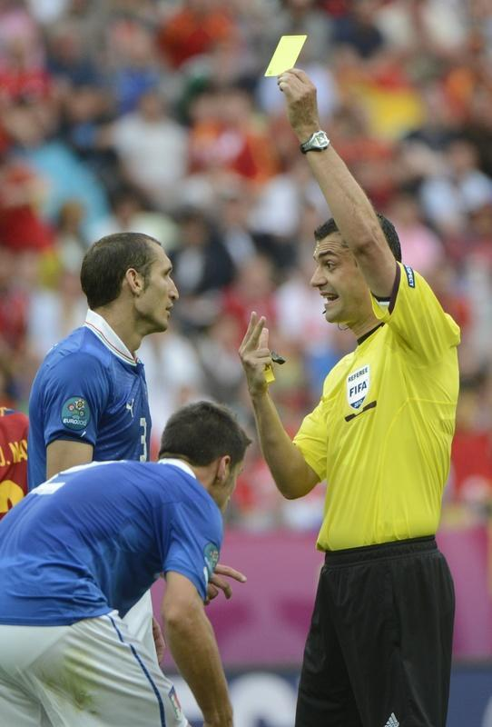 Italian defender Giorgio Chiellini (L) is given a yellow card by Hungarian referee Viktor Kassai during the Euro 2012 championships football match Spain vs Italy on June 10, 2012 at the Gdansk Arena. AFP PHOTO / PIERRE-PHILIPPE MARCOUPIERRE-PHILIPPE MARCOU/AFP/GettyImages