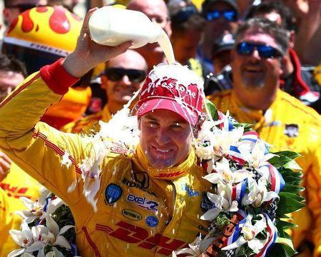 May 25, 2014; Indianapolis, IN, USA; IndyCar Series driver Ryan Hunter-Reay dumps the milk on his head as he celebrates after winning the 2014 Indianapolis 500 at Indianapolis Motor Speedway. Mark J. Rebilas-USA TODAY Sports