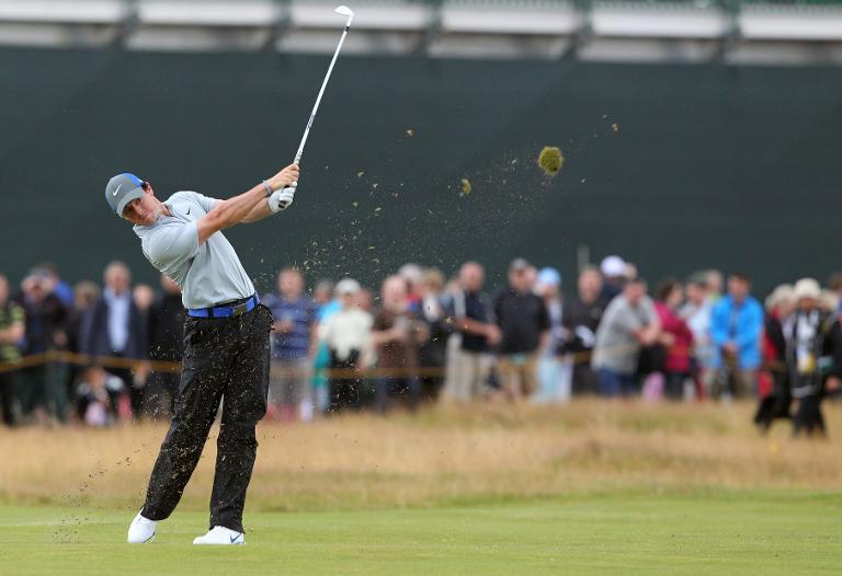 Northern Ireland's Rory McIlroy plays his approach to the 14th green during his third round 68, on day three of the British Open Golf Championship at Royal Liverpool Golf Course in Hoylake, on July 19, 2014