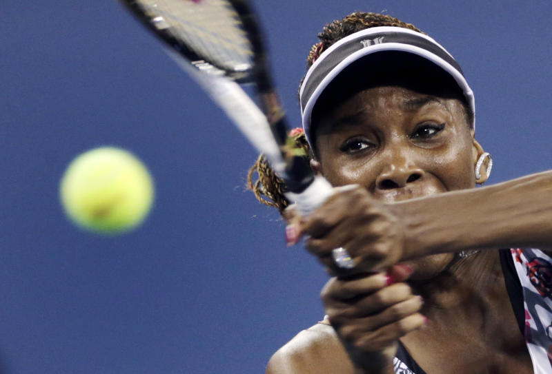 Venus Williams keeps her eyes on the ball as she returns to Angelique Kerber, of Germany, in the second round of play at the U.S. Open tennis tournament, Thursday, Aug. 30, 2012, in New York. (AP Photo/Charles Krupa)