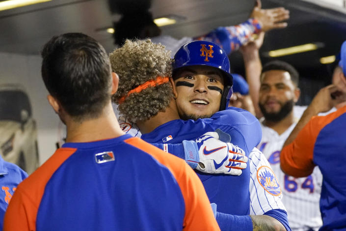 New York Mets' Javier Baez celebrates with teammates after hitting a two-run home run in the sixth inning of the baseball game against the Cincinnati Reds, Saturday, July 31, 2021, in New York. (AP Photo/Mary Altaffer)