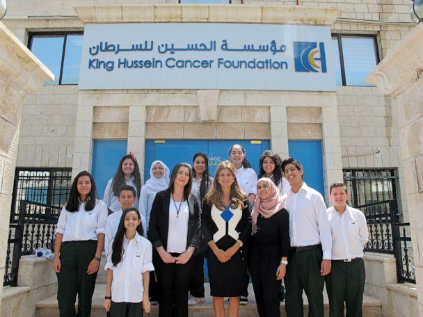 PHOTO: Dina Mired stands outside the King Hussein Cancer Center with students visiting the facilities. (Dina Mired)