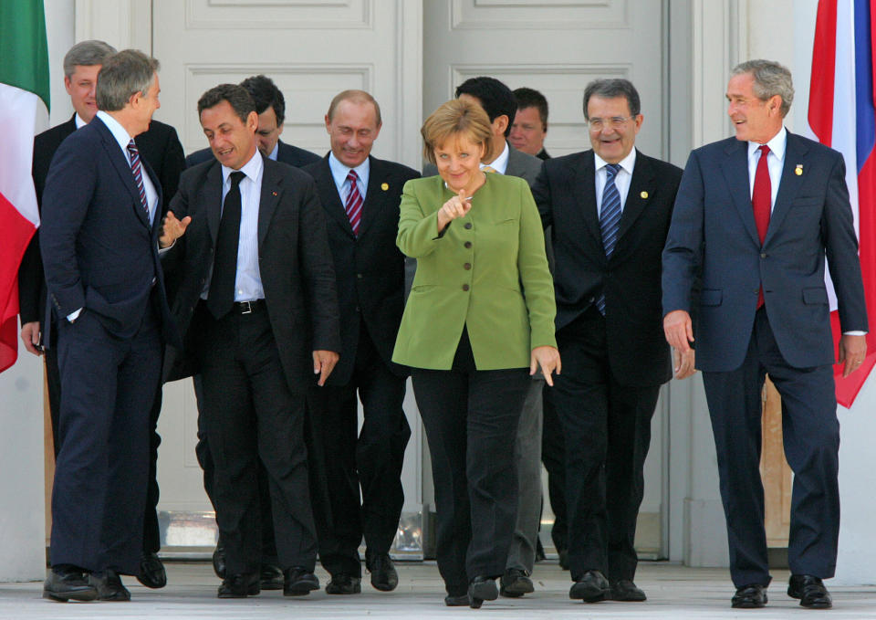 FILE - In this Thursday, June 7, 2007 file photo, German Chancellor Angela Merkel, center, U.S. President George Bush, Italian Premier Romano Prodi, Japanese Premier Shinzo Abe, Russian President Vladimir Putin, French President Nicolas Sarkozy, EU Commission President Jose Manuel Barroso, British Premier Tony Blair and Canadian Premier Stephen Harper walk to their family photo during the G8 summit in Heiligendamm, Germany. Merkel has also been lauded as an impressive role model for girls both at home and around the globe for standing up to male leaders. (AP Photo/Michael Probst, File)