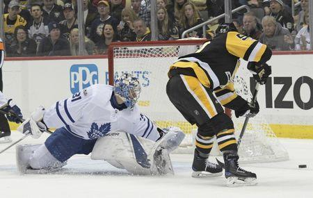 Dec 9, 2017; Pittsburgh, PA, USA; Toronto Maple Leafs goalie Frederik Andersen (31) forces Pittsburgh Penguins center Jake Guentzel (59) wide of the goal during the first period at PPG PAINTS Arena. Mandatory Credit: Don Wright-USA TODAY Sports