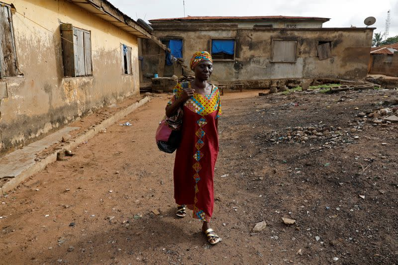 The Wider Image: It's never too late to learn says 50-year-old Nigerian school pupil