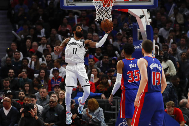 Brooklyn Nets guard Kyrie Irving (11) drives on the Detroit Pistons in the second half of an NBA basketball game in Detroit, Saturday, Jan. 25, 2020. (AP Photo/Paul Sancya)