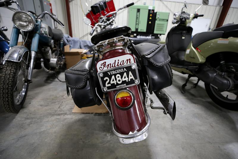 The company also sells motorcycles, including antiques, pictured, Friday, May 24, 2019, at Everything But The House warehouse in Blue Ash.