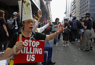 Protesters raise placards as they march on the streets against an extradition bill in Hong Kong on Sunday, June 16, 2019. Hong Kong residents Sunday continued their massive protest over an unpopular extradition bill that has highlighted the territory's apprehension about relations with mainland China, a week after the crisis brought as many as 1 million into the streets. (AP Photo/Vincent Yu)