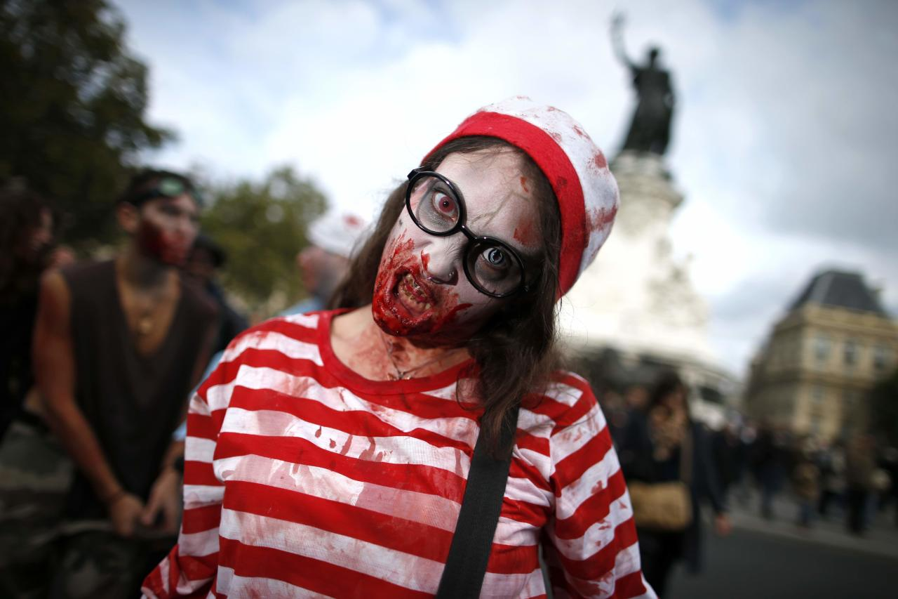 A woman dressed as a zombie participates in a Zombie Walk procession in the streets of Paris October 12, 2013. REUTERS/Benoit Tessier (FRANCE - Tags: SOCIETY TPX IMAGES OF THE DAY)