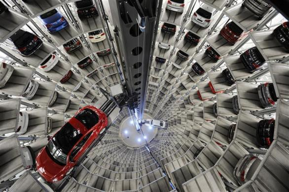 """A Volkswagen """"Beetle"""" (L) and an """"UP!"""" are pictured in a delivery tower at the company's headquarter in Wolfsburg, Germany March 12, 2012."""