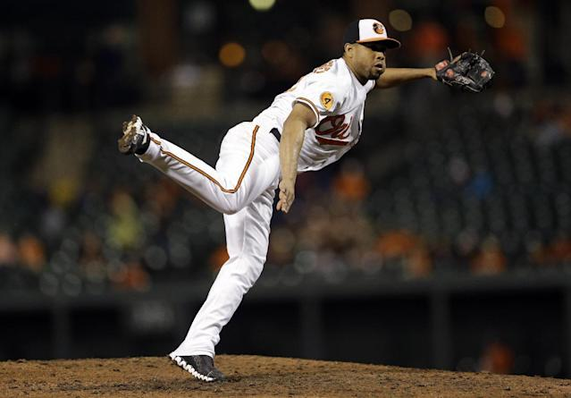 Baltimore Orioles relief pitcher Francisco Rodriguez follows through on a pitch to the Toronto Blue Jays during a baseball game, Tuesday, Sept. 24, 2013, in Baltimore. Toronto won 3-2 in ten innings. (AP Photo/Patrick Semansky)