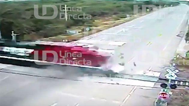 Debris can be seen flying everywhere after the bus ran over the crossing which has no warning lights of barriers. Photo: Supplied