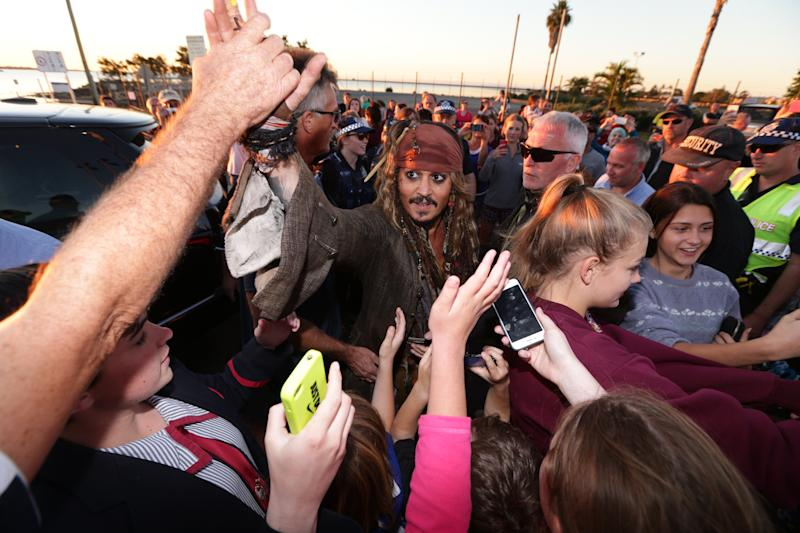 CLEVELAND, AUSTRALIA - JUNE 2: (EUROPE AND AUSTRALASIA OUT) American actor Johnny Depp, dressed as 'Captain Jack Sparrow', greets locals at Cleveland in Redland City, Queensland, after a day of filming 'Pirates of the Caribbean: Dead Men Tell No Tales'. (Photo by Peter Wallis/Newspix/Getty Images)