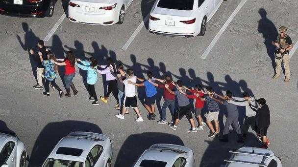 PHOTO: People are brought out of the Marjory Stoneman Douglas High School after a shooting at the school, Feb. 14, 2018, in Parkland, Fla. (Joe Raedle/Getty Images)