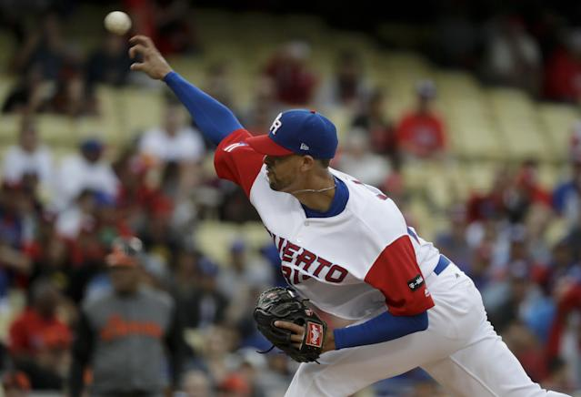 <p>Puerto Rico starting pitcher Jorge Lopez throws to the Netherlands in the first inning of a semifinal in the World Baseball Classic in Los Angeles, Monday, March 20, 2017. (AP Photo/Chris Carlson) </p>