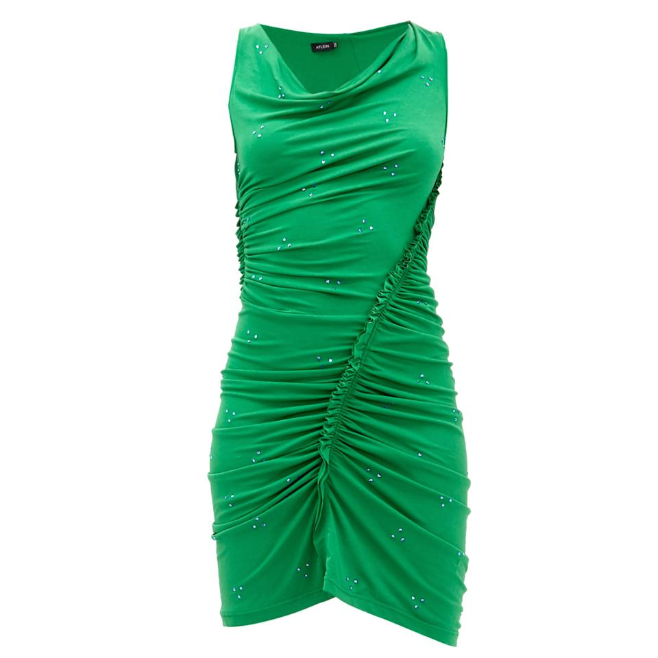 """<p>Antonin Tron, the designer behind the brand Atlein, is redefining everyday materials like jersey in a nuanced and versatile fashion. For example, find this emerald, crystallized mini dress. Such attention to detail as seen with the subtle ruching is Tron's speciality.</p> <p><strong>Buy now:</strong> Atlein dress, $1,282, <a href=""""https://www.matchesfashion.com/us/products/Atlein-Ruched-crystal-embellished-crepe-dress-1309420"""">matchesfashion.com</a>.</p>"""