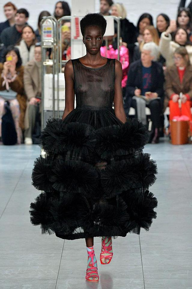 <p>A sheer black and ruffled-skirt dress at the Molly Goddard FW18 show. (Photo: Getty) </p>