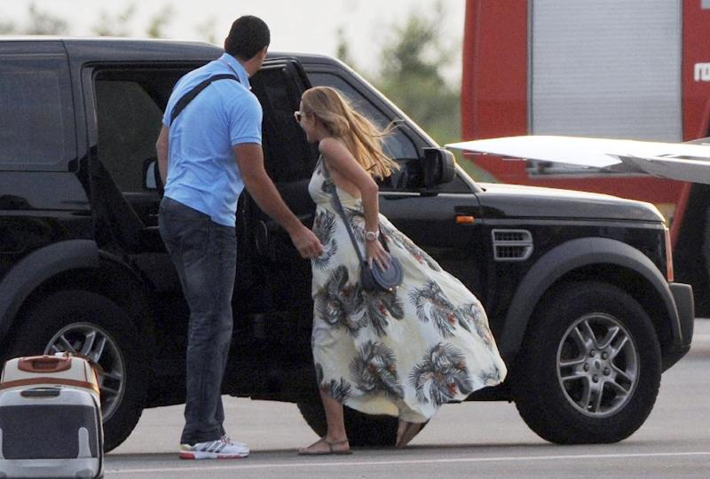 Jelena Ristic, longtime girlfriend and future wife of Serbian tennis player Novak Djokovic, enters a vehicle after landing at Tivat airport on July 8, 2014