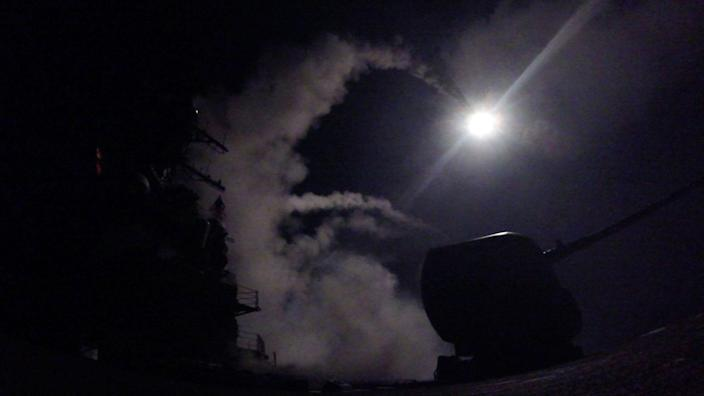 <p>The guided-missile destroyer Porter fires a Tomahawk missile at a Syrian air base in retaliation for chemical weapons attack against civilians. (Mass Communication Specialist 3rd Class Ford Williams/U.S. Navy via AP) </p>