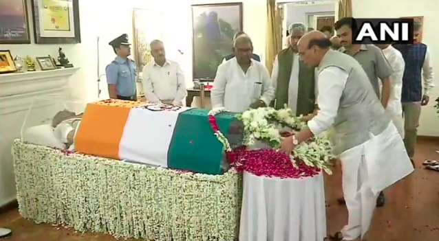 <p>Home Minister Rajnath Singh paying tributes to Vajpayee. </p>