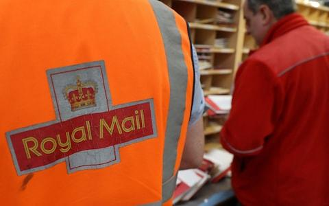 Royal Mail workers at a sorting office - Credit: PA