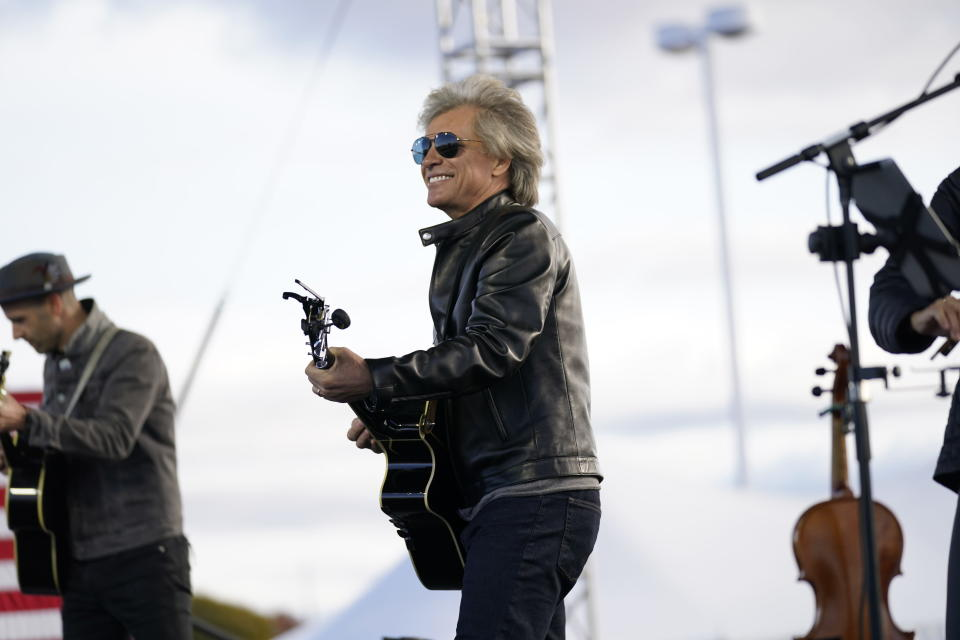 Musician Jon Bon Jovi performs at a campaign event for Democratic presidential candidate former Vice President Joe Biden at Dallas High School in Dallas, Pa., Saturday, Oct. 24, 2020. (AP Photo/Andrew Harnik)