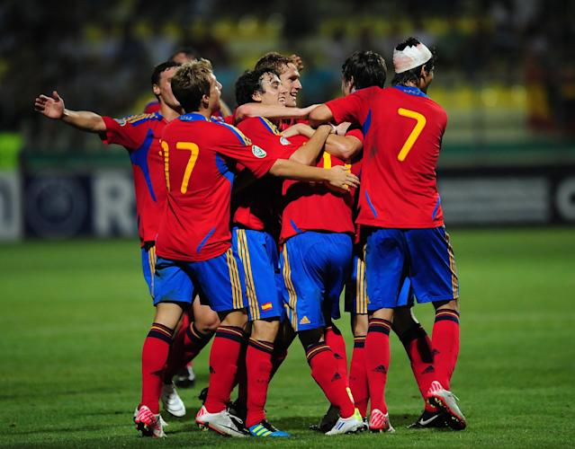 Spanish team players celebrate their second score against Ireland during their UEFA European Under-19 Championship football match, near the village of Chiajna village, outside of Bucharest, on July 29, 2011. AFP PHOTO/DANIEL MIHAILESCU (Photo credit should read DANIEL MIHAILESCU/AFP/Getty Images)