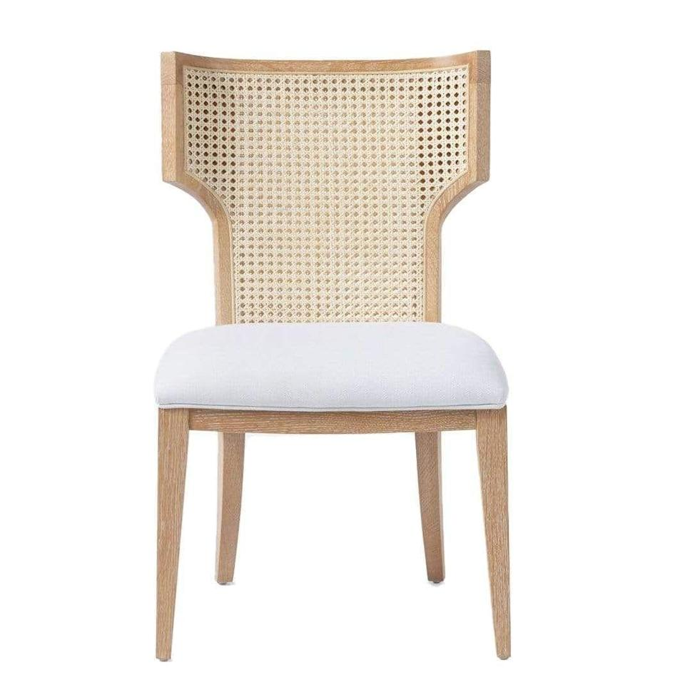 "<p><strong>Made Goods</strong></p><p>meadowblu.com</p><p><strong>$1500.00</strong></p><p><a href=""https://meadowblu.com/products/made-goods-carleen-cane-dining-chair"" rel=""nofollow noopener"" target=""_blank"" data-ylk=""slk:Shop Now"" class=""link rapid-noclick-resp"">Shop Now</a></p><p>The Carleen Cane dining chair by Made Goods has an oh-so subtle winged back that makes the hours spent lingering at the dinner table ever more comfortable and inviting.</p>"