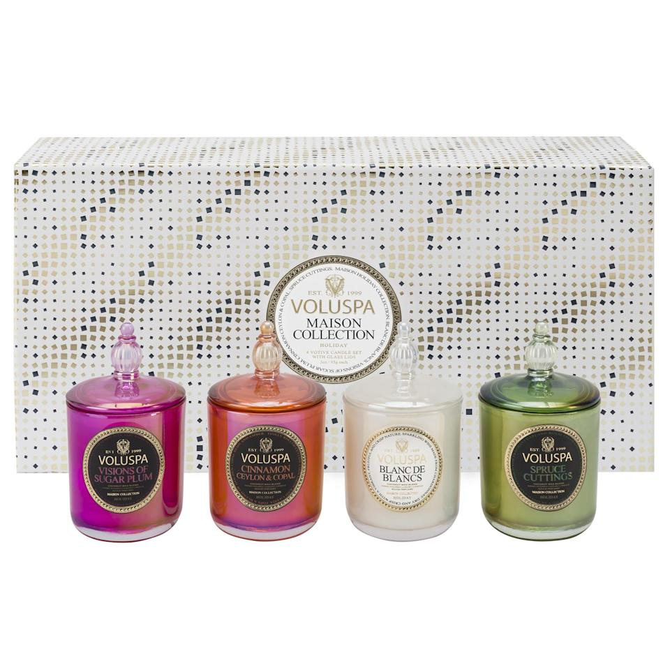 """<p>Likely the workaholic will be stuck at the office. But that doesn't mean she can't get in the festive mood. Channel the holidays with these scented Voluspa candles. </p><p>Buy it <a rel=""""nofollow noopener"""" href=""""https://www.voluspa.com/shop/maison-holiday/4-votive-candle-holiday-gift-set/assorted/"""" target=""""_blank"""" data-ylk=""""slk:here"""" class=""""link rapid-noclick-resp"""">here</a> for $65.</p>"""