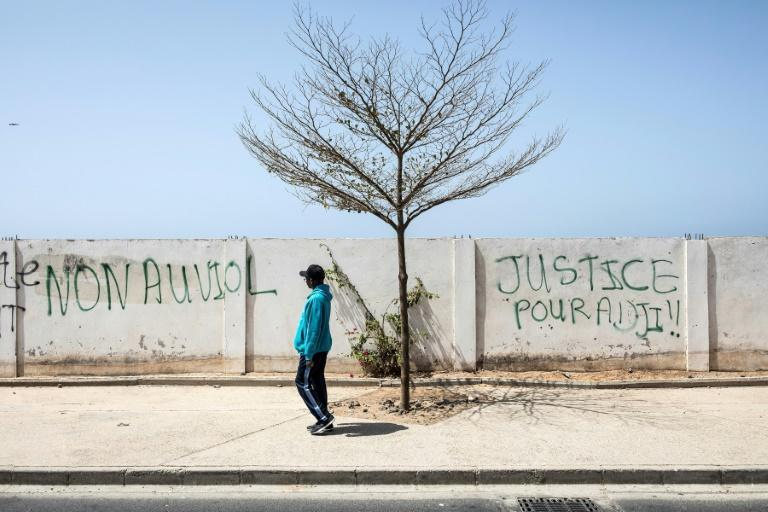 """Grafitti in Senegal's Dakar reads """"Justice for Adji"""", referring to the woman who has accused the opposition leader of rape"""
