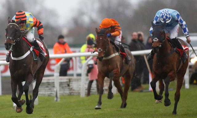 Might Bite and Nico de Boinville (left) win the King George VI at Kempton Park on Boxing Day.