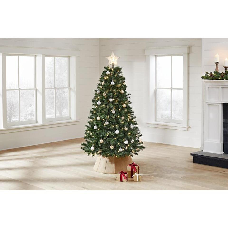 """<p><strong>Home Accents Holiday</strong></p><p>homedepot.com</p><p><strong>$49.98</strong></p><p><a href=""""https://go.redirectingat.com?id=74968X1596630&url=https%3A%2F%2Fwww.homedepot.com%2Fp%2FHome-Accents-Holiday-6-5-ft-Festive-Pine-Pre-Lit-Artificial-Christmas-Tree-with-250-Color-Changing-LED-Lights-and-3-Functions-W14L0550%2F312482786&sref=https%3A%2F%2Fwww.thepioneerwoman.com%2Fholidays-celebrations%2Fg34522896%2Fbest-artificial-christmas-trees%2F"""" rel=""""nofollow noopener"""" target=""""_blank"""" data-ylk=""""slk:Shop Now"""" class=""""link rapid-noclick-resp"""">Shop Now</a></p><p>This budget-friendly artificial pine comes pre-decorated with 250 color-changing LED lights. The 750 artificial pine branches give the tree a fuller look. </p><p><em>Height: 6.5 feet </em></p>"""