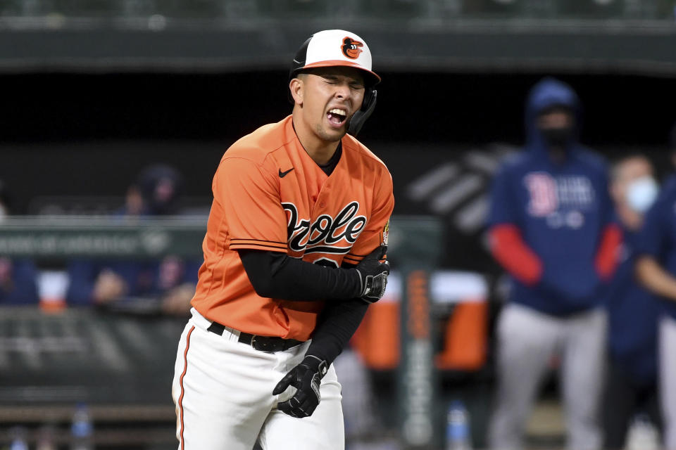 Baltimore Orioles' Ramon Urias reacts after being hit by a pitch in the ninth inning of a baseball game against the Boston Red Sox, Saturday, May 8, 2021, in Baltimore. (AP Photo/Will Newton)
