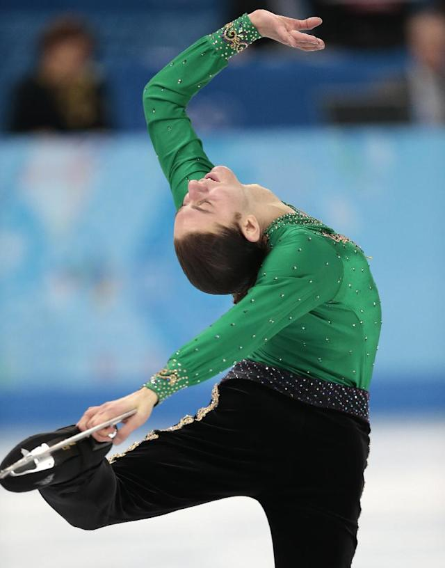 Jason Brown of the United States competes in the men's free skate figure skating final at the Iceberg Skating Palace during the 2014 Winter Olympics, Friday, Feb. 14, 2014, in Sochi, Russia. (AP Photo/Ivan Sekretarev)