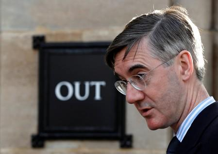 Britain's Conservative Party MP Jacob Rees-Mogg walks outside the Houses of Parliament in London