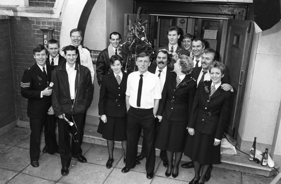 Cast of 'The Bill' in 1988. Back: Mark Powley, Larry Dann, Colin Blumenau, Jon Iles, Mark Wingett, Christopher Ellison and Tony Scannell. Front: Roger Leach, Jeff Stewart, Kelly Lawrence, Eric Richard, Kevin Lloyd, Barbara Thorn and Trudie Goodwin. (Photo by Douglas Doig/Express/Getty Images)