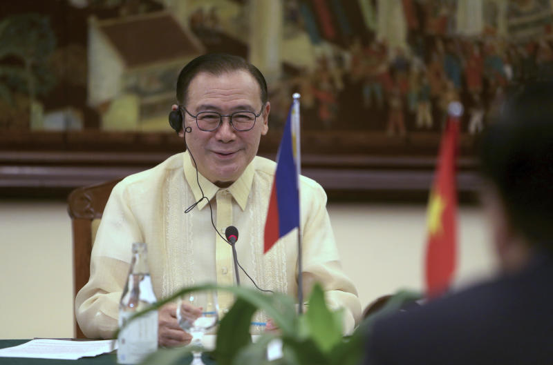 FILE PHOTO: Philippine Foreign Affairs Secretary Teodoro Locsin Jr. speaks to Vietnamese Foreign Minister Pham Binh Minh in Hanoi, Vietnam Monday, July 8, 2019. (AP Photo/Hau Dinh)