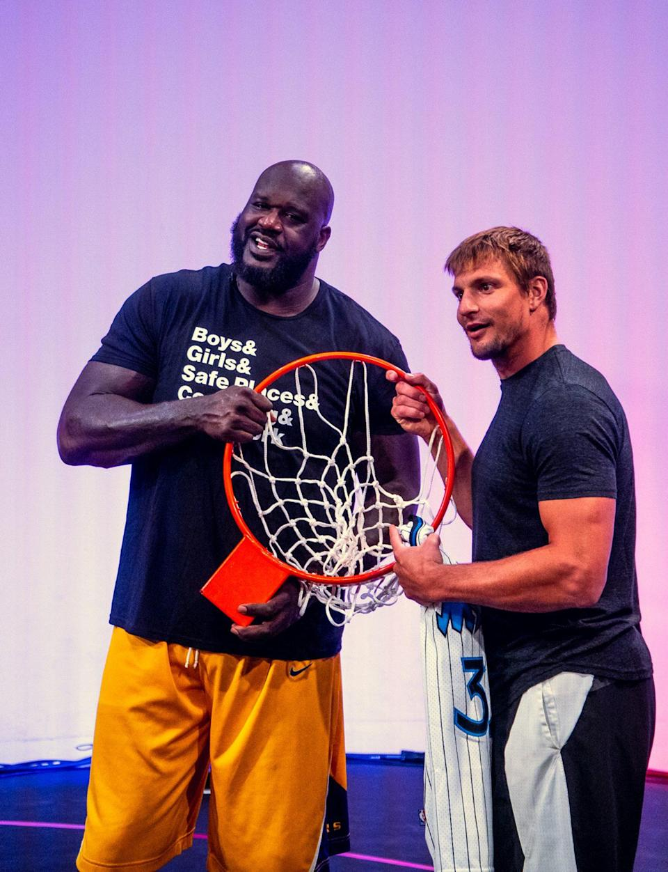 <p>Shaq breaks his hoop during a digital game of HORSE against Rob Gronkowski powered by fans on his website using the Yappa commenting tool on Saturday.</p>