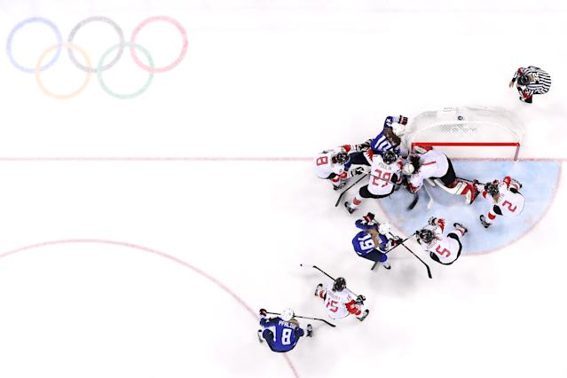 <p>Meghan Duggan #10 of the United States battles for the puck in the third period against Canada during the Women's Gold Medal Game on day thirteen of the PyeongChang 2018 Winter Olympic Games at Gangneung Hockey Centre on February 22, 2018 in Gangneung, South Korea. (Photo by Bruce Bennett/Getty Images) </p>