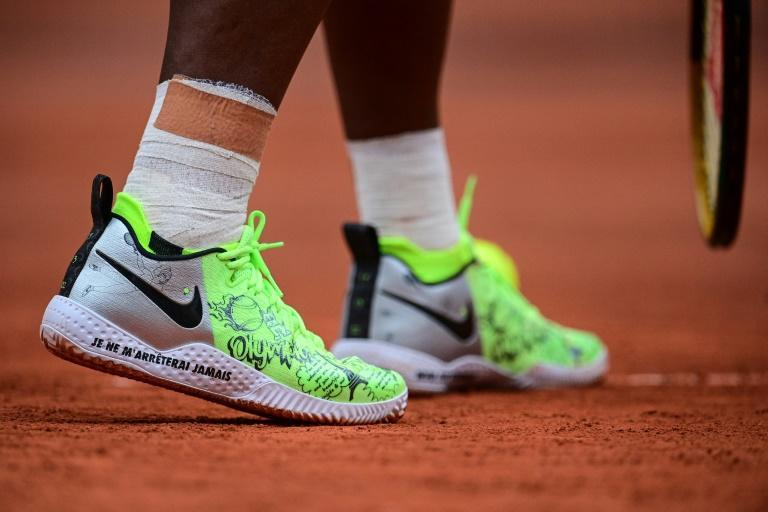 """The shoes of Serena Williams bear the message """"I will never stop"""""""