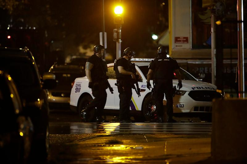 Authorities continue their investigation of a shooting where multiple police officers were shot, Wednesday, Aug. 14, 2019, in Philadelphia.