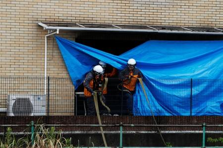 Firefighters check the torced Kyoto Animation building in Kyoto